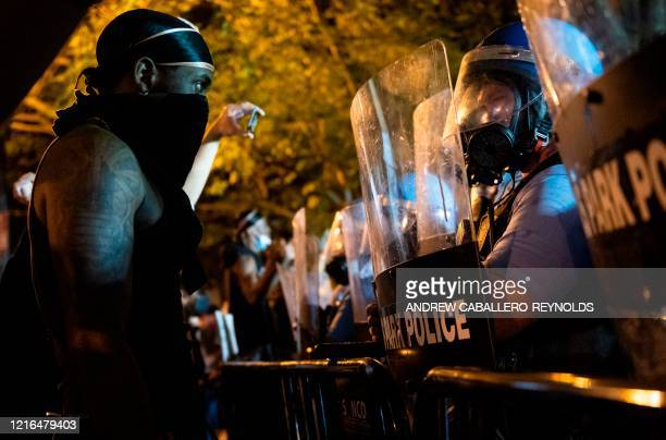 TOPSHOT Military Police face off with protesters across from the White House on May 30 2020 in Washington DC during a protest over the death of...