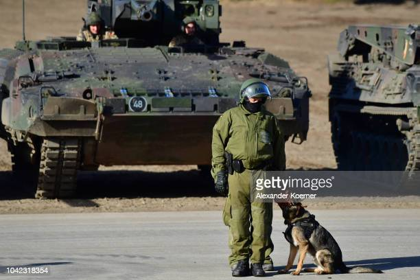 Military Police forces of the Bundeswehr demonstrate their skills during a threeday Bundeswehr exercise on September 28 2018 near Munster Germany...