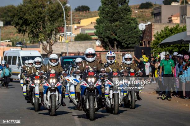 Military Police lead the front of the convoy leading the body of Winnie Mandela to Orlando Stadium for her funeral on April 14 in Soweto South Africa...