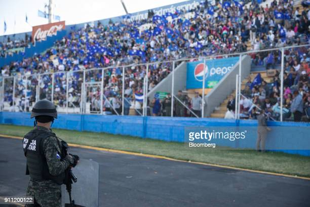 Military police officer stands guard during the presidential inauguration at the National Stadium in Tegucigalpa, Honduras, on Saturday, Jan. 27,...