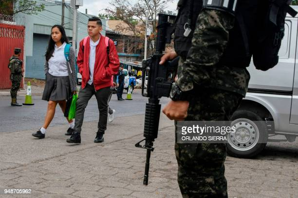 A military police officer stands guard in the surroundings of a school in Tegucigalpa on April 18 2018 Students are also victims of the prevailing...