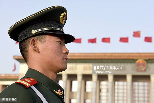 A military police officer stands in front of the Great Hall of the People during the opening session of the China's National People's Congress on...