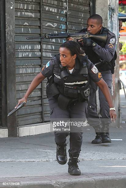 Military Police officers patrol in the Cidade de Deus 'City of God' favela community during an ongoing police operation on November 20 2016 in Rio de...