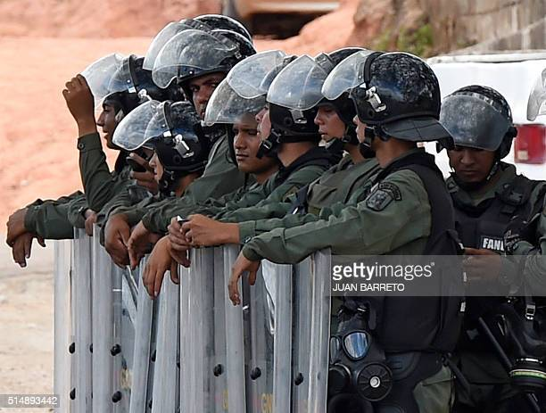 Military police officers patrol the streets of Tumeremo Bolivar state Venezuela on March 11 2016 Twentyeight miners failed to return home from work...
