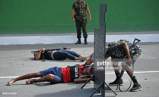 Military police officers play the role of drug traffickers as they take part in a training simulation at Alvaro Braga military base in Villa Miliar...