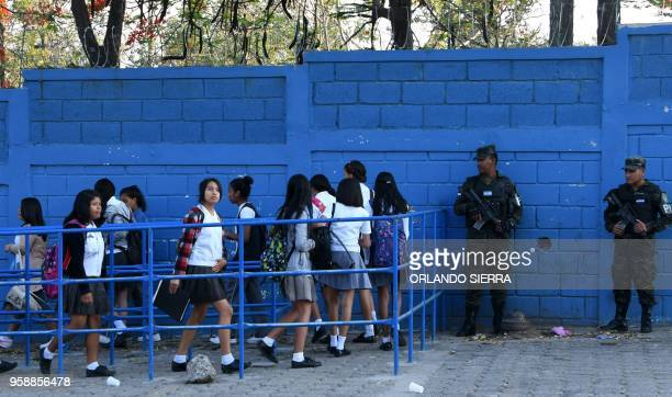Military Police officers provide security against gang activity at the entrance of a high school in Tegucigalpa taken on May 13 2018 Missionaries...