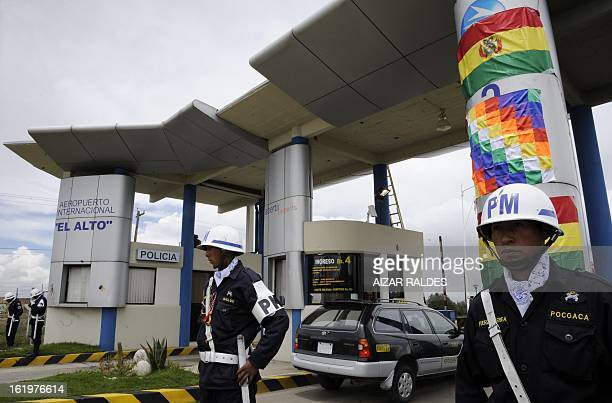 Military police officers stand guard at the entrance of the airport of El Alto 12 km from La Paz on the day Bolivian President Evo Morales announced...