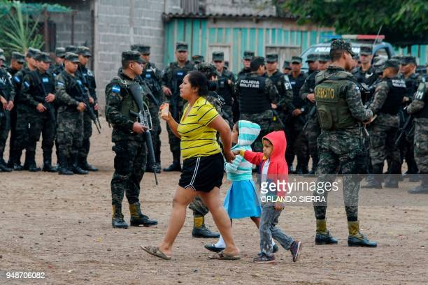 TOPSHOT Military police officers stand guard outside a school in Tegucigalpa on April 18 2018 Students are also victims of the prevailing insecurity...