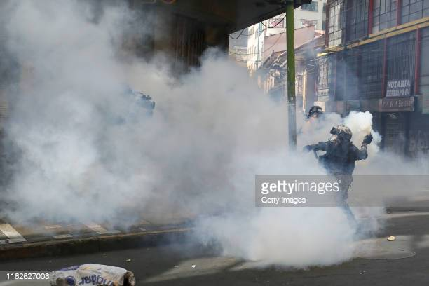 A military police officers throws a tear gas bomb to demonstrators during a protest on November 15 2019 in La Paz Bolivia Morales flew to Mexico...