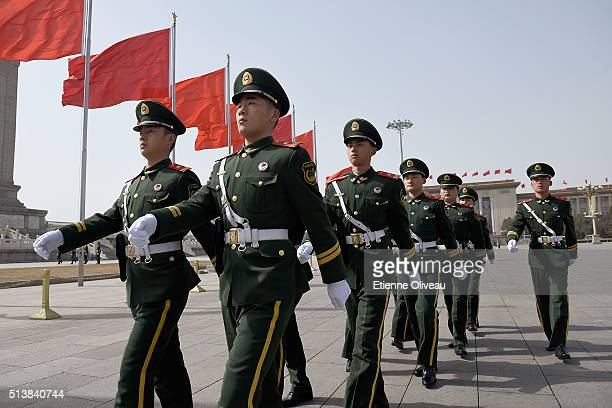 Military police officers walk through Tiananmen Square during the opening session of the China's National People's Congress on March 5 2016 in...