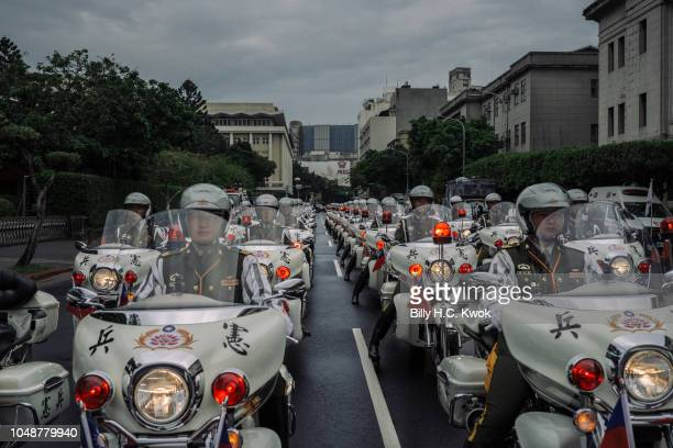 Military police on motorcycles perform to mark the island's National Day celebrations in front of the Presidential Palace on October 10, 2018 in...