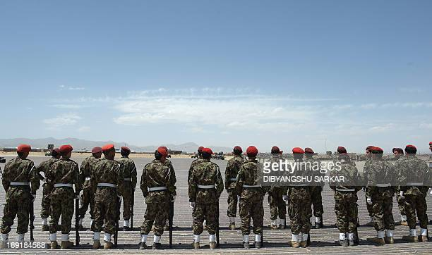 Military Police personel of Afghan National Army prepare to present a guard of hounour to their general on his arrival at the Provintial Head...