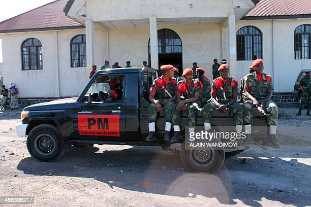 Military police sit on a van outside Goma's military court on May 5 during the trial of several soldiers accused of rape and murder during a 2012...