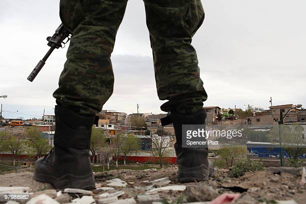 Military police stand guard at the scene of a murder on March 23 2010 in Juarez Mexico Secretary of State Hillary Rodham Clinton Defense Secretary...