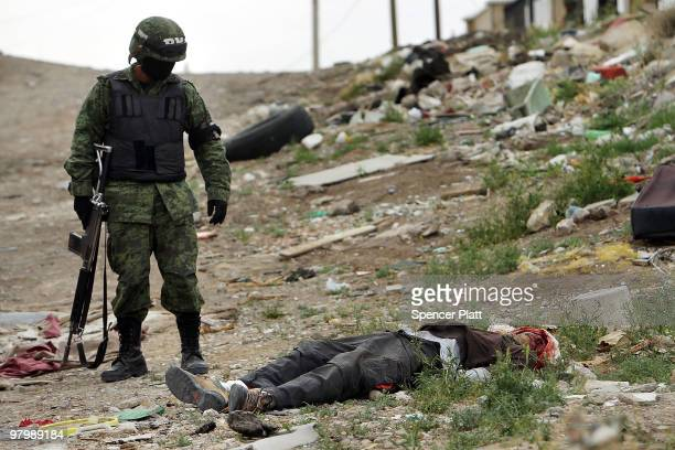 Military police stand guard at the scene of a murder on March 23, 2010 in Juarez, Mexico. Secretary of State Hillary Rodham Clinton, Defense...