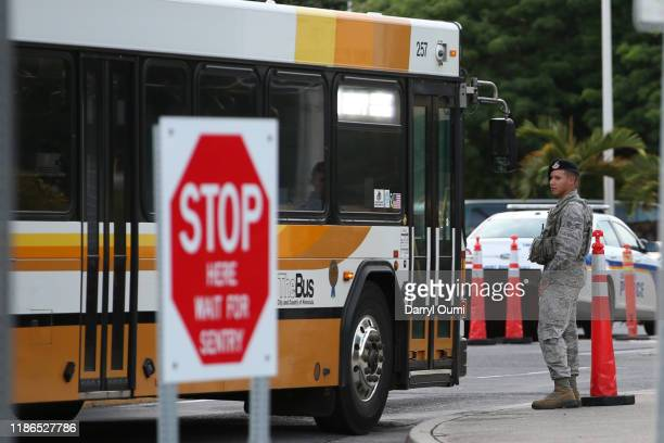 Military Police stop a city bus before allowing it to enter Joint Base Pearl HarborHickam on December 4 2019 in Honolulu United States Early reports...
