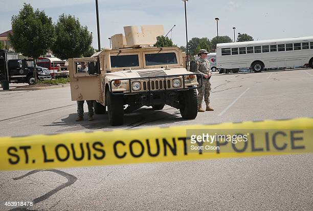 Military police with the Missouri Army National Guard stand guard at the police command center which was established to direct security operations...