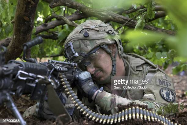 Military policeman Pfc Jeremy Wilbanks aiming his machinegun, May 5, 2018. Image courtesy Sgt. 1st Class Debra Richardson / 319th Mobile Public...