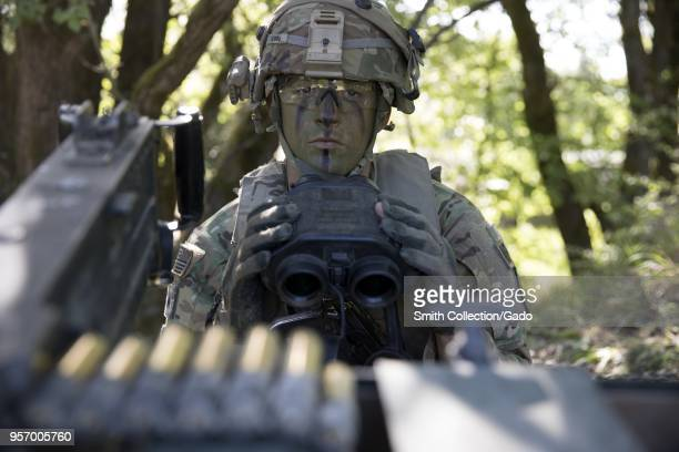 Military policeman Sgt Trace Tubbs prepares to use binoculars, May 6, 2018. Image courtesy Sgt. 1st Class Debra Richardson / 319th Mobile Public...