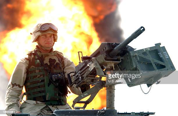 A military policeman with the 220th Military Police Company Army Spec Joshua Earl from Denver Colorado mans a MK19 automatic grenade launcher while...