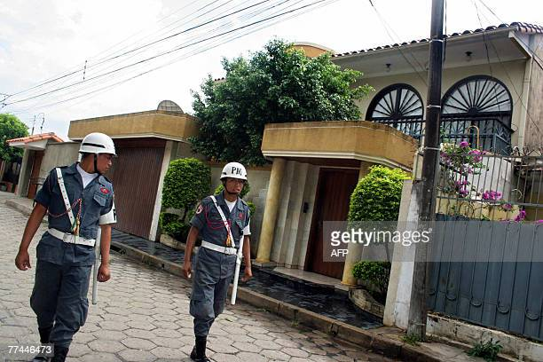 Military policemen patrol the street of the Venezuelan consulate in the Bolivian city of Santa Cruz on October 22nd after an explosive device was...