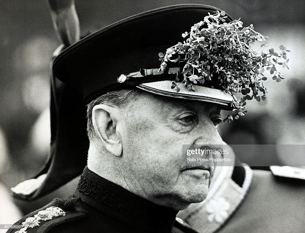 Military Politics. England. pic: 17th March 1966. Viscount Alexander, (1891-1969) pictured wearing shamrock sprigs in his cap at a St.Patrick's Day parade in London, where he distributed shamrock to the Irish Guards. A commander in World War II rising to : News Photo