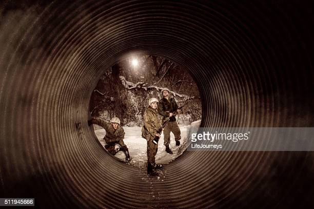 wwii us military reconnissance team inspecting an abandoned aqueduct - military invasion stock pictures, royalty-free photos & images