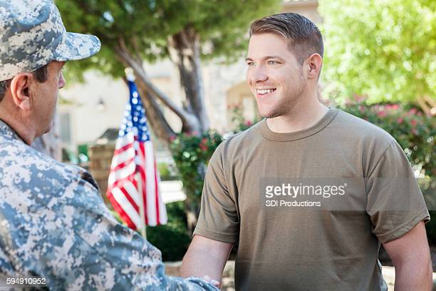 military recruitment officer meeting with superior to discuss enlisting recruits - recruiter stock pictures, royalty-free photos & images