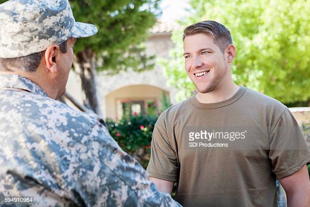 military recruitment officers meeting to discuss enlisting recruits - american influenced stock photos and pictures