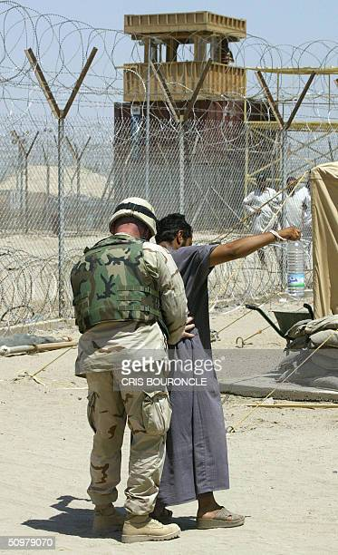 US military review board plays jury to Iraq's 6000 detainees by Ned Parker A US Army soldier frisks an Iraqi prisoner before entering into the...