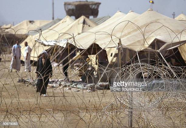 US military review board plays jury to Iraq's 6000 detainees by Ned Parker Iraqi prisoners at Camp Gancy wait to be relocated to a better location...