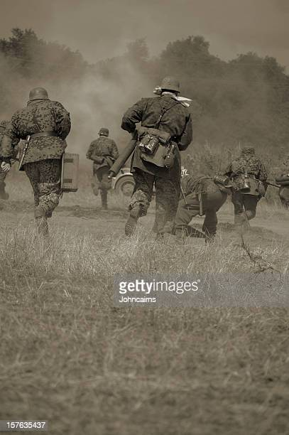 military running in sepia tones - dunkirk evacuation stock pictures, royalty-free photos & images