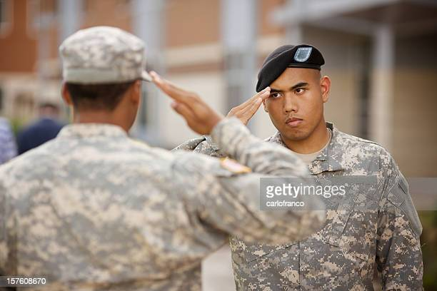rotc military salute at a college campus - saluting stock pictures, royalty-free photos & images