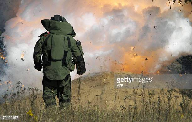 Military sapper watches an explosion during an exercise by the Slovakian multiple-function battalion from Hlohovec at a military practice range near...
