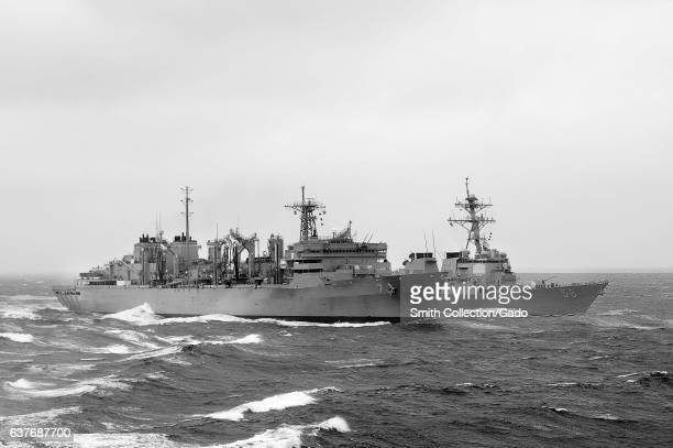 Military Sealift Command fast combat support ship USNS Rainier and Arleigh Burkeclass guidedmissile destroyer USS John S McCain during a...