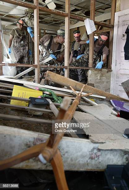 Military search and rescue crews check a house for any bodies on September 7 2005 in Port Sulfur Louisiana Hurricane Katrina demolished the entire...