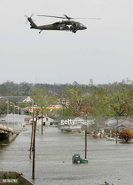 A military search and rescue helicopter passes over the lower Ninth Ward September 24 2005 in New Orleans Louisiana The lower Ninth Ward was flooded...