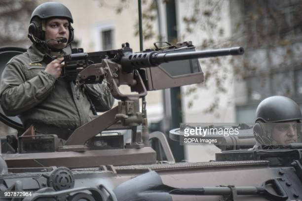 Military seen inside a tank during the parade Military parade in Athens for The Greek Revolution or Revolution of 1821 was a successful armed...