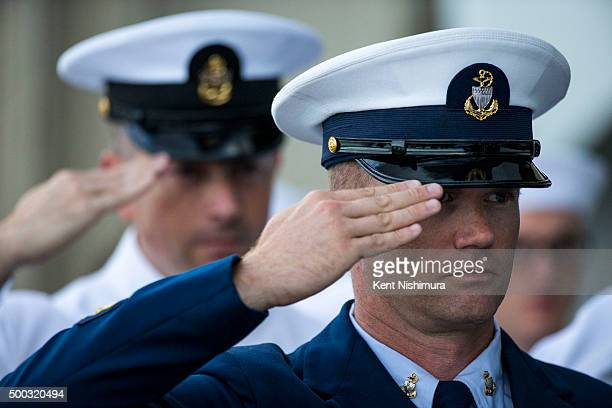Military Service members salute during the procession of the Joint Services Color Guard during a memorial service marking the 74th Anniversary of the...