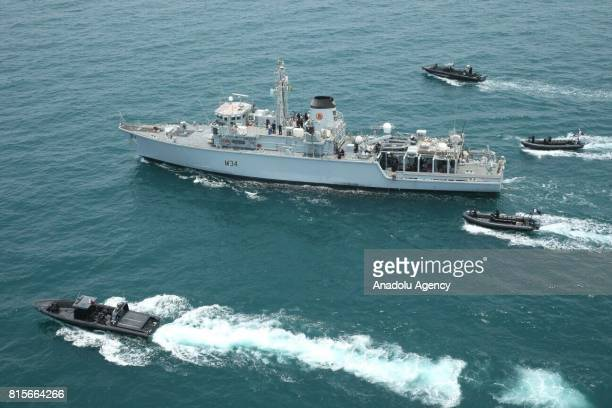 Military ships belonging to Qatar and United Kingdom attend a joint military exercise in Qatar's territorial waters in Doha Qatar on July 16 2017