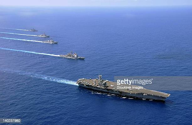military ships operate in formation in the south china sea. - navy ship stock pictures, royalty-free photos & images