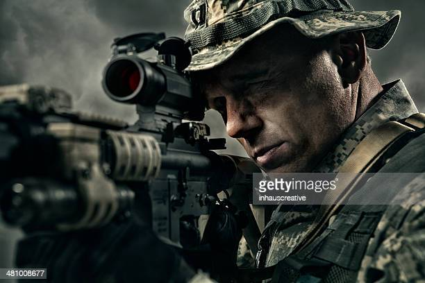 Military Sniper prepares to take a shot