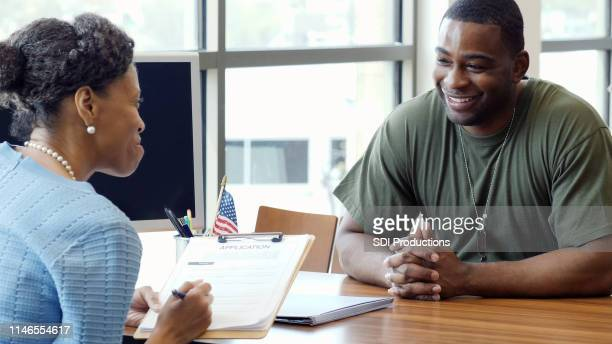 military solder applies for bank loan - veteran stock pictures, royalty-free photos & images