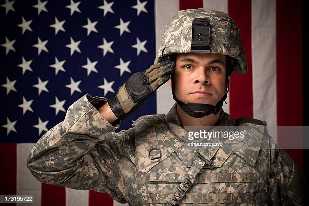 military soldier in front of american flag - saluting stock pictures, royalty-free photos & images