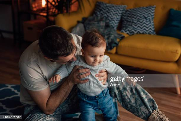 Military soldier playing with his son