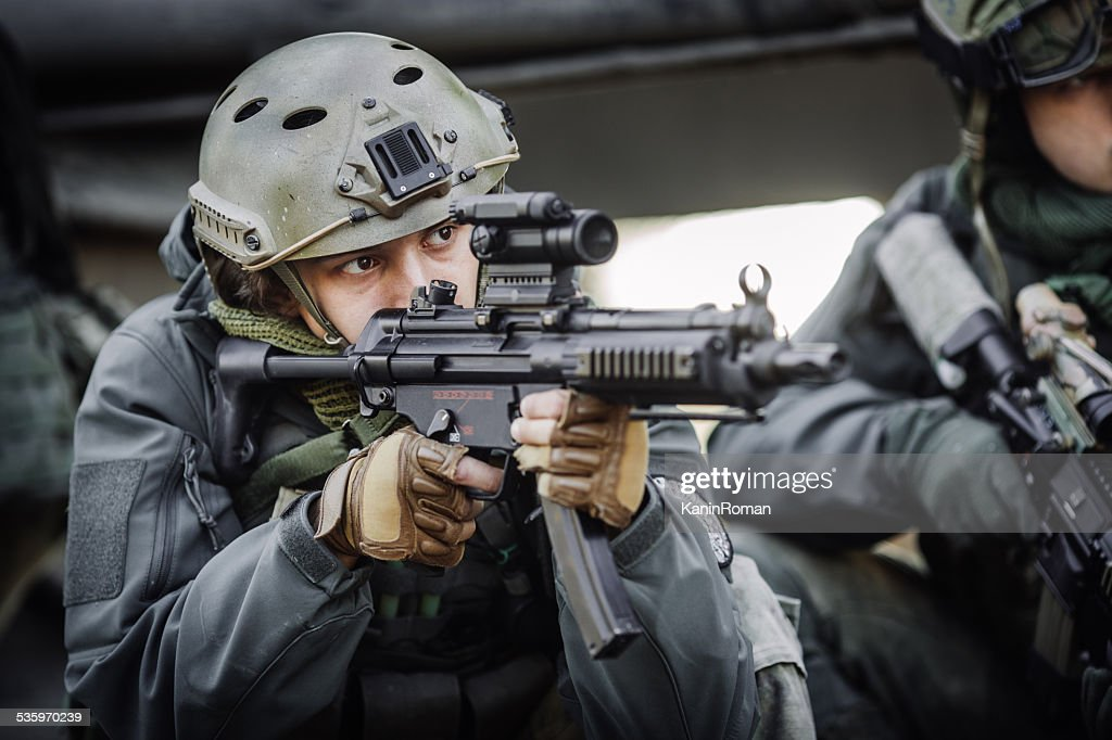 military soldier shooting an assault rifle : Stock Photo