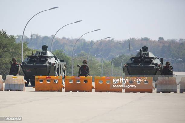 Military soldiers with tanks and police truck block the road near parliament in Naypyidaw this afternoon in Myanmar on February 1, 2021. Myanmar's...