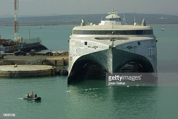 S military speedboat passes by the USAV Spearhead an experimental highspeed troop transporter February 22 2003 at the port at Djibouti Town Djibouti...