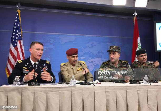US military spokesman Colonel Ryan Dillon speaks as Iraqi security forces spokesmen Brigadier General Yahya Rasool Brigadier General Halgwrd Hikman...