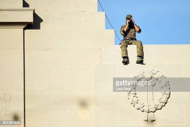 A military spotter overlooks proceedings from the Menin Gate in the town market square on July 30 2017 in Ypres Belgium Dignitaries and descendants...